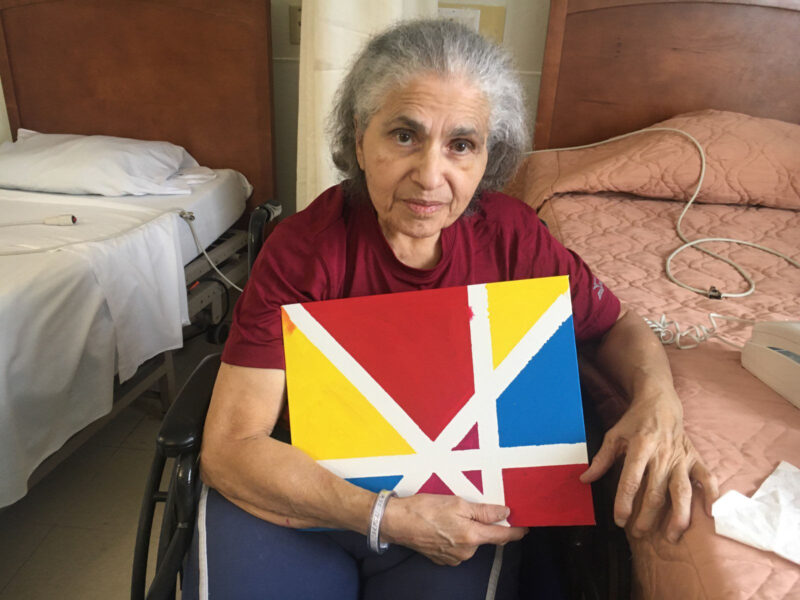 Woman with colorful red, yellow and blue painting
