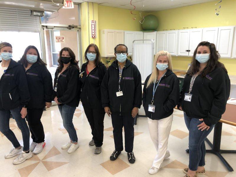 Employees modeling hoodies