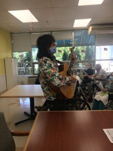 Singing and playing guitar