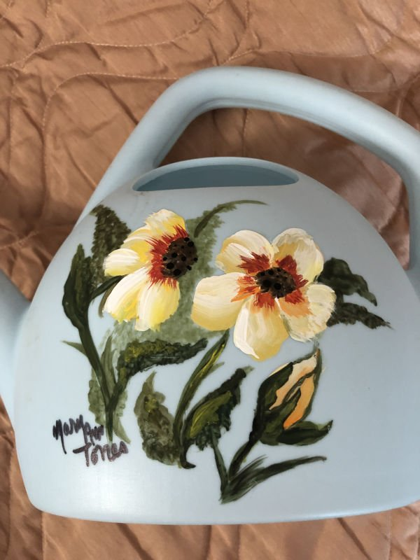 Painted flowers on watering can