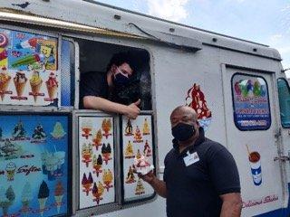 Employee gets ice cream from ice cream truck