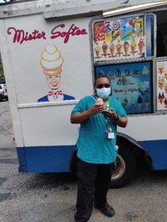 Employee poses with ice cream