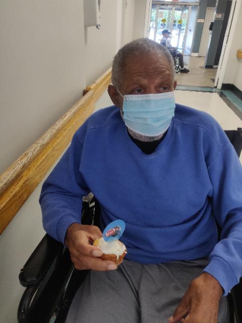 Man holding cupcake