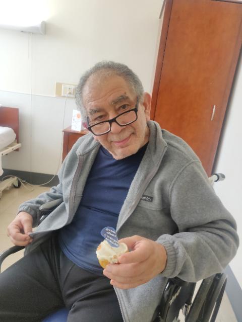 Man holds cupcake