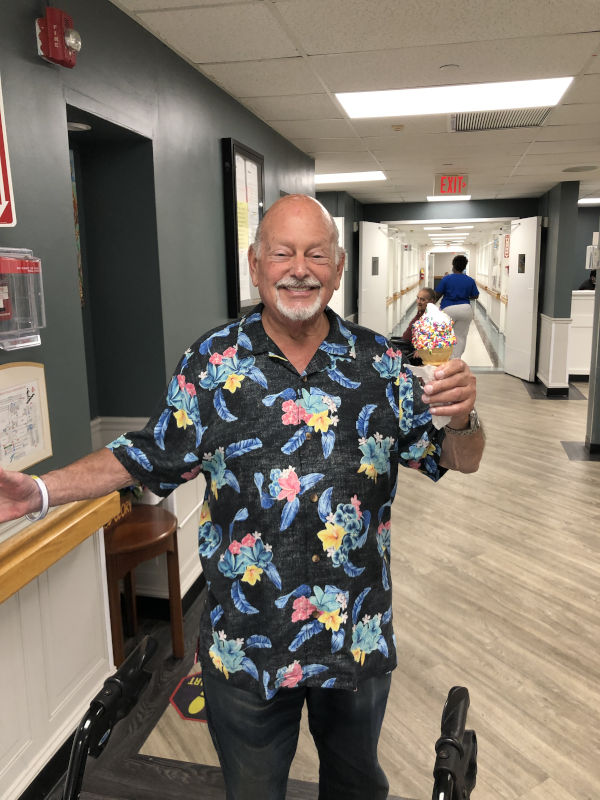 Man smiling and holding ice cream
