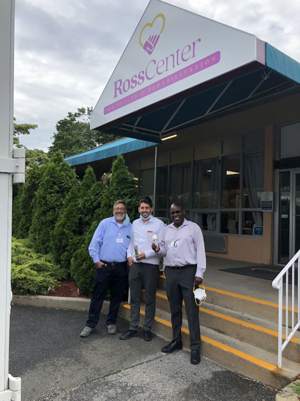 Employees in front of Ross Center holding ice creams