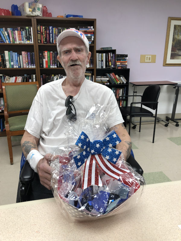 Male 4th of July winner with his basket