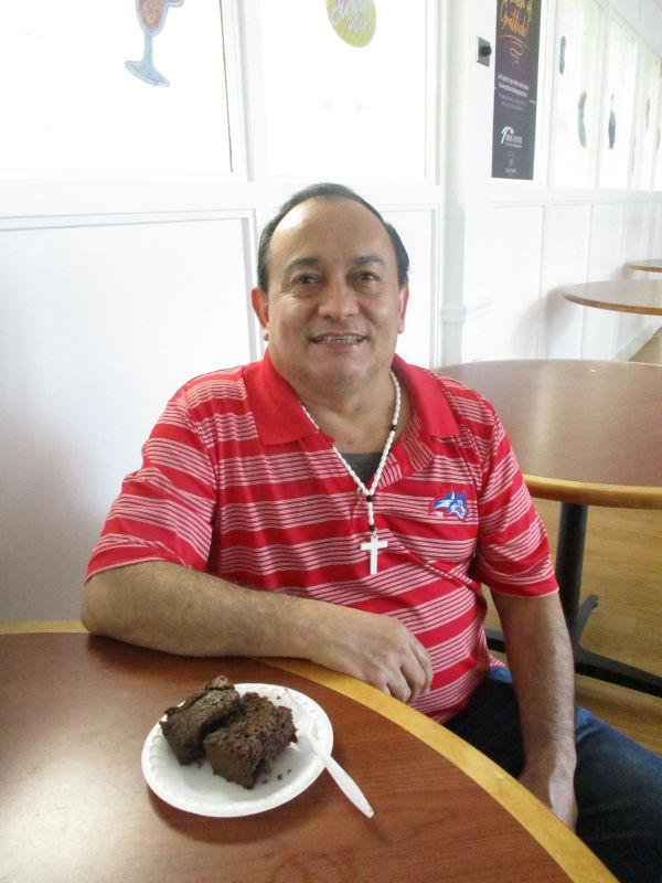 Gentleman enjoying chocolate cake