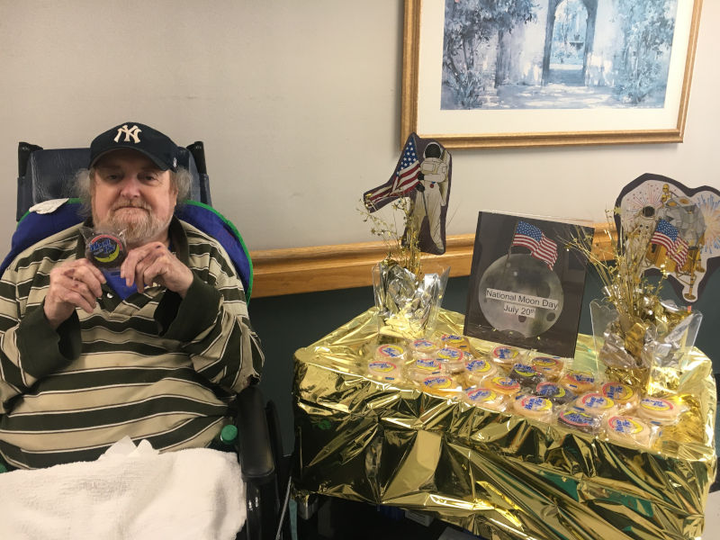 Man holding Moon Pie next to National Moon Day table